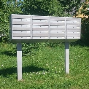 Apartment mailbox on a metal rack